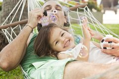 Family in a hammock blowing bubbles Stock Photography
