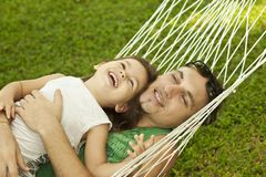 Family in a hammock on the nature Royalty Free Stock Photo