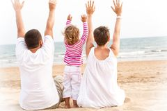 Family with hand up are looking the ocean Stock Image
