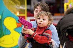 Family with handgun Royalty Free Stock Photos