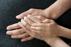 Family Hands. Family holding hands together with father, mother, and child Royalty Free Stock Photo