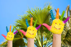 Family hands with smiles against palm Stock Photography
