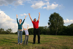 Family with hands up. On meadow Royalty Free Stock Photos