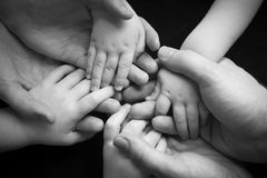 Family of Hands. A young family of four holding hands Royalty Free Stock Photos