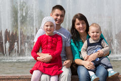 Family happily spending time at the fountain Stock Photography