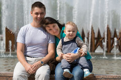 Family happily spending time at the fountain Royalty Free Stock Photography