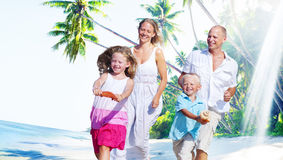 Family Happiness Beach Tropical Paradise Fun Concept Stock Images