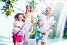 Family Happiness Beach Tropical Paradise Fun Concept.  Royalty Free Stock Image