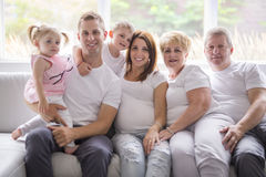 Family, happiness, generation and people concept on the sofa stock photo