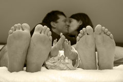 Family happiness with newborn baby. In bed Royalty Free Stock Images