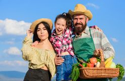 Family happy cheerful farmers gardeners. Family farmers proud of fall harvest. Harvest festival concept. Life in. Countryside benefits. Parents and daughter stock images