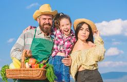 Family happy cheerful farmers gardeners. Family farmers proud of fall harvest. Harvest festival concept. Life in stock photo