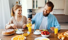 Family happy couple have Breakfast in kitchen in morning royalty free stock photography