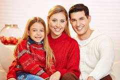 Family with happy daughter at christmas. Smiling family with happy daughter at christmas eve stock photos