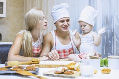 Family, happy daughter with dad and mom in home kitchen laughing. And preparing food together, with love royalty free stock images