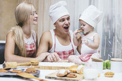 Family, happy daughter with dad and mom in home kitchen laughing Royalty Free Stock Image