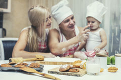 Family, happy daughter with dad and mom in home kitchen laughing Royalty Free Stock Photography