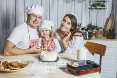Family, happy daughter with mom and dad at home in the kitchen l Stock Photography