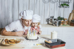 Family, happy daughter with my dad at home in the kitchen laugh Stock Image