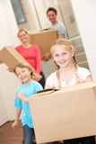 Family happy on moving day Stock Images