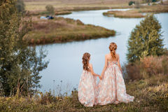 Family happy outdoors. The Mother and daughter in matching dresses royalty free stock photos