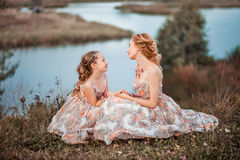 Family happy outdoors. The Mother and daughter in matching dresses stock photos