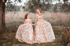 Family happy outdoors. The Mother and daughter in matching dresses stock images