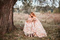 Family happy outdoors. The Mother and daughter in matching dresses royalty free stock images