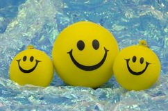 Family of happy smileys. Over a bright pearly background Royalty Free Stock Photos