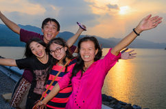Family happy during the sunset Royalty Free Stock Photography