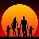 Family. Happy family with three children around sunset hour Stock Photo