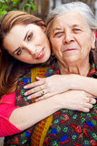 Family - happy young woman and grandmother stock images