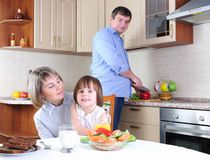 Family has breakfast in the kitchen stock photography
