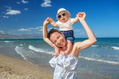 Family has fun at the seashore in summertime.  royalty free stock images