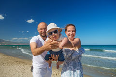 Family has fun at the seashore. In summertime royalty free stock photo