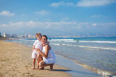 Family has fun at the seashore. In summertime royalty free stock photos