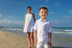Family has fun at the seashore in summertime.  royalty free stock photos
