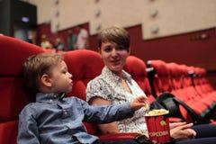 Family has popcorn Royalty Free Stock Photography