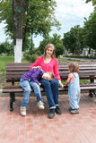 Family has a rest in summer park Royalty Free Stock Photos