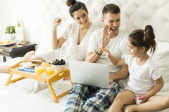 Family have breakfest on the bed Royalty Free Stock Images