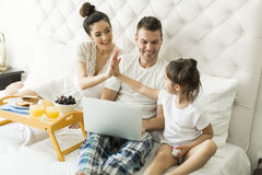Family have breakfest on the bed Royalty Free Stock Photos