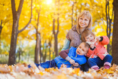 Family have fun in the autumn park Stock Photo
