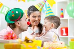 Family have fun celebrating birthday of child son Royalty Free Stock Image