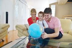 Family have fun with globe Stock Image