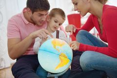 Family have fun with globe Royalty Free Stock Photo