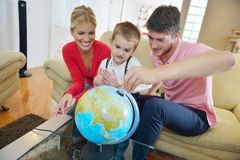 Family have fun with globe Royalty Free Stock Image