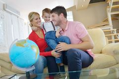 Family have fun with globe Royalty Free Stock Photography