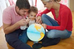 Family have fun with globe Royalty Free Stock Photos