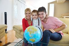Family have fun with globe Stock Photography