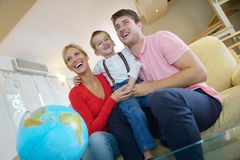 Family have fun with globe Royalty Free Stock Images